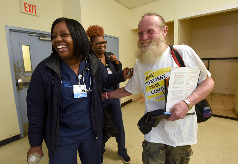 Patient and care team happily great each other